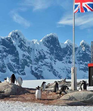 Port Lockroy, a natural harbour in front of the Antarctic Peninsula. The Antarctic base includes the most southerly operational post office in the world.