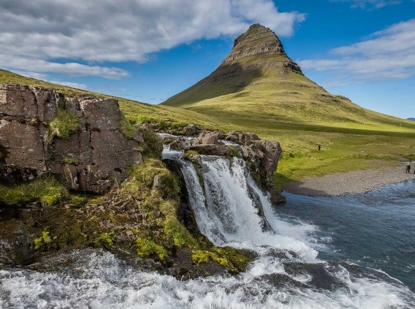 Mt. Kirkjufell and Kirkjufellsfoss waterfall in Grundarfjördur. The West region of Iceland offers spectacular views and is the home to thrilling Viking sagas of ancient times. A highlight is the Westfjords, a stunning nature reserve where teeming bird cliffs are abundant.