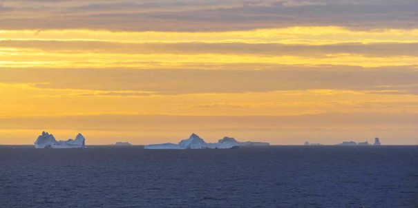 Amazing colors and icebergs in the sunset, crossing the Davis Strait