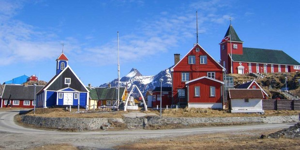Idyllic Sisimiut with wooden church and colorful houses.