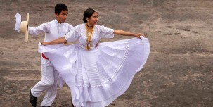 Young couple dancing in Paracas.