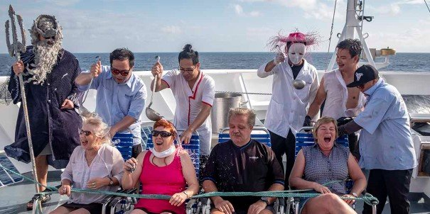 Take part in the special baptism when crossing the Equator.
