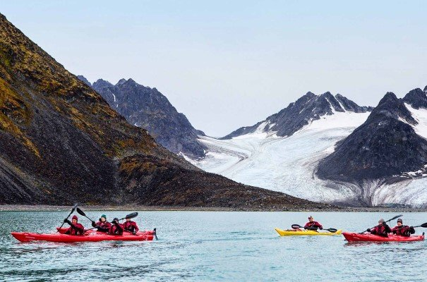 Kayaking in the Magdalenefjord, Svalbard. There will be great opportunities for exciting activities such as hiking, kayaking and more on land and water during this Svalbard holiday, as we explore great national parks and some of the most spectacular highlights of the Arctic