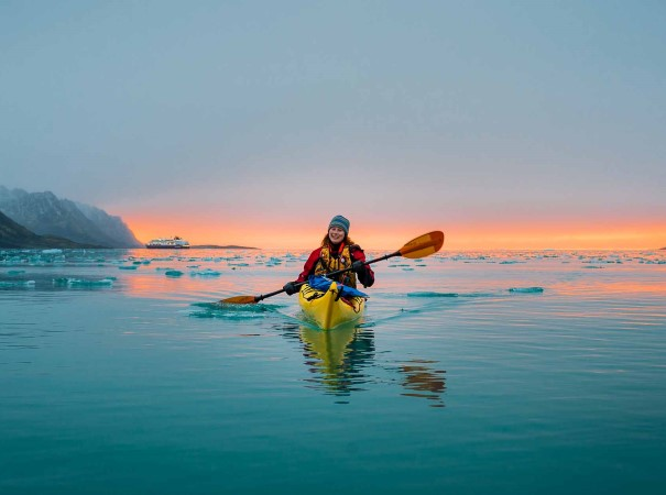 Kayaking in Magdalenefjord at sunset. Hurtigruten has unmatched experience in Svalbard – dating back as far as 1896.  On this voyage we will visit the North-Western coast of Svalbard, a stunning region of pristine nature.