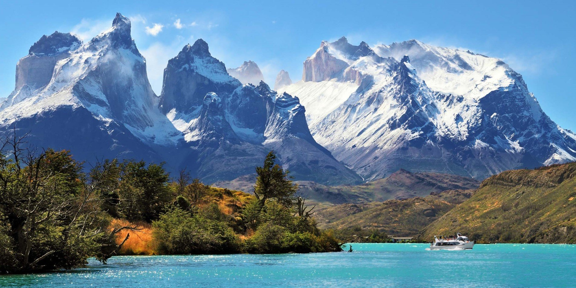 A view of a snow covered mountain with Torres del Paine National Park in the background