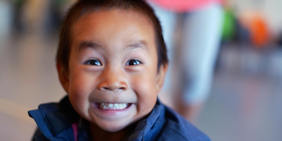 A young child smiling at the camera
