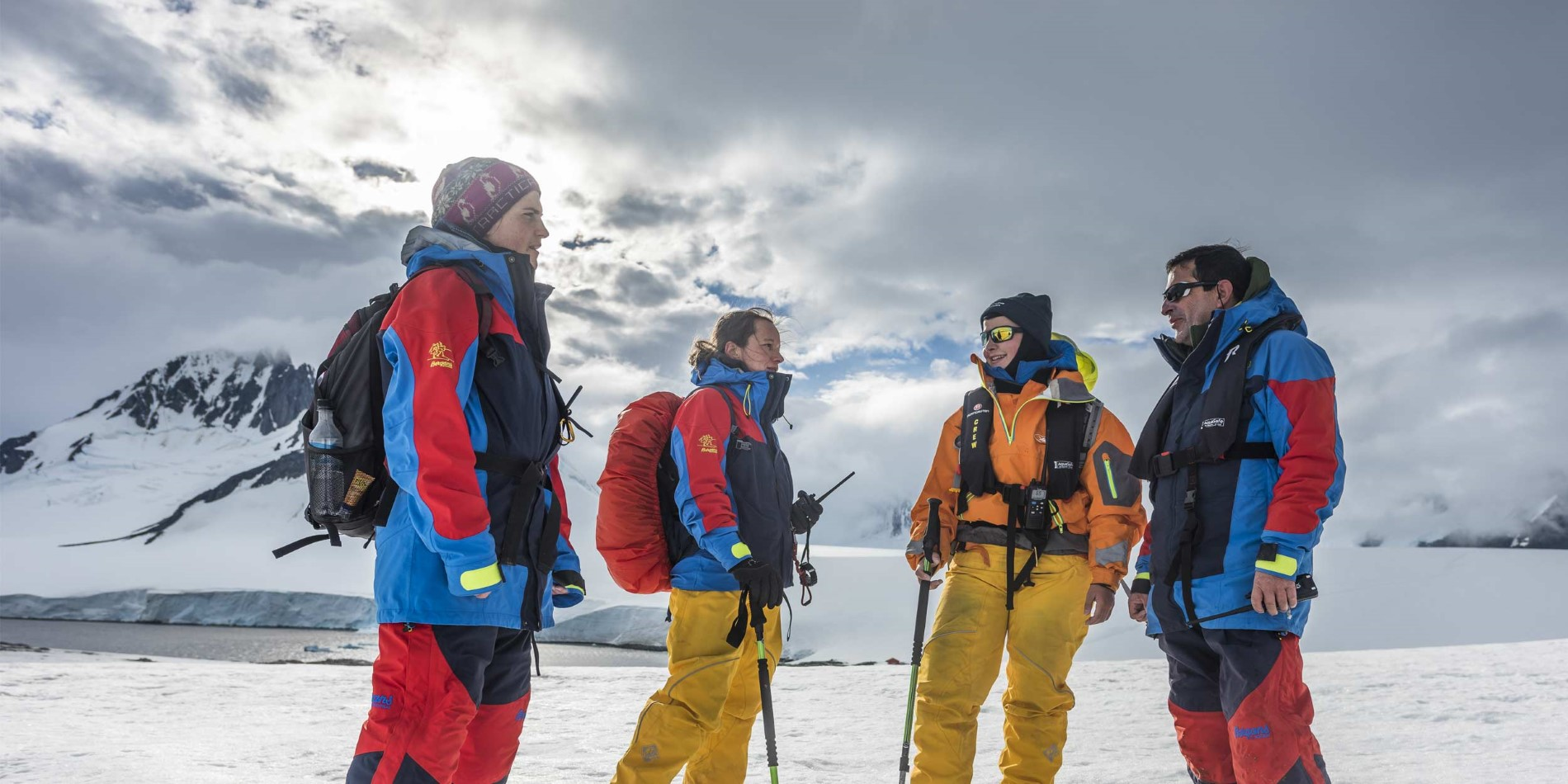 Expedition Team planning a hike in Damoy Point, Antarctica