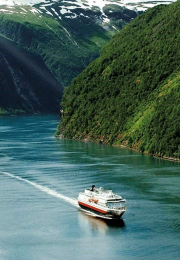 Hurtigruten sailing through Geirangerfjorden in Norway