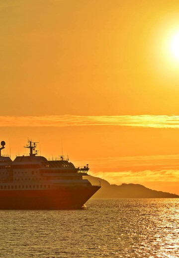 MS Polarlys bathing in the midnight sun in Norway