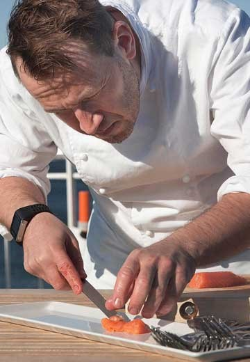 Chef on board Norway's Coastal Kitchen with Hurtigruten