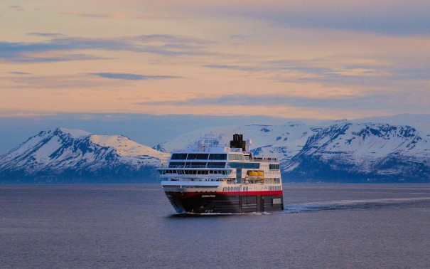 MS Midnatsol sailing through the Norwegian winter landscape