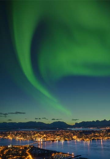 Northern Lights over the city of Tromso in northern Norway