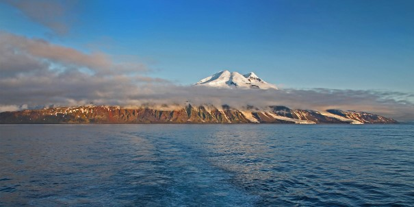 We head across the Arctic Ocean towards Jan Mayen island.  The cone of Beerenburg volcanic peak rises more than 6,500 feet over the tiny Norwegian station of Olonkinbyen. Coming ashore on this rugged island can be difficult, but if conditions allow, we will attempt a landing.