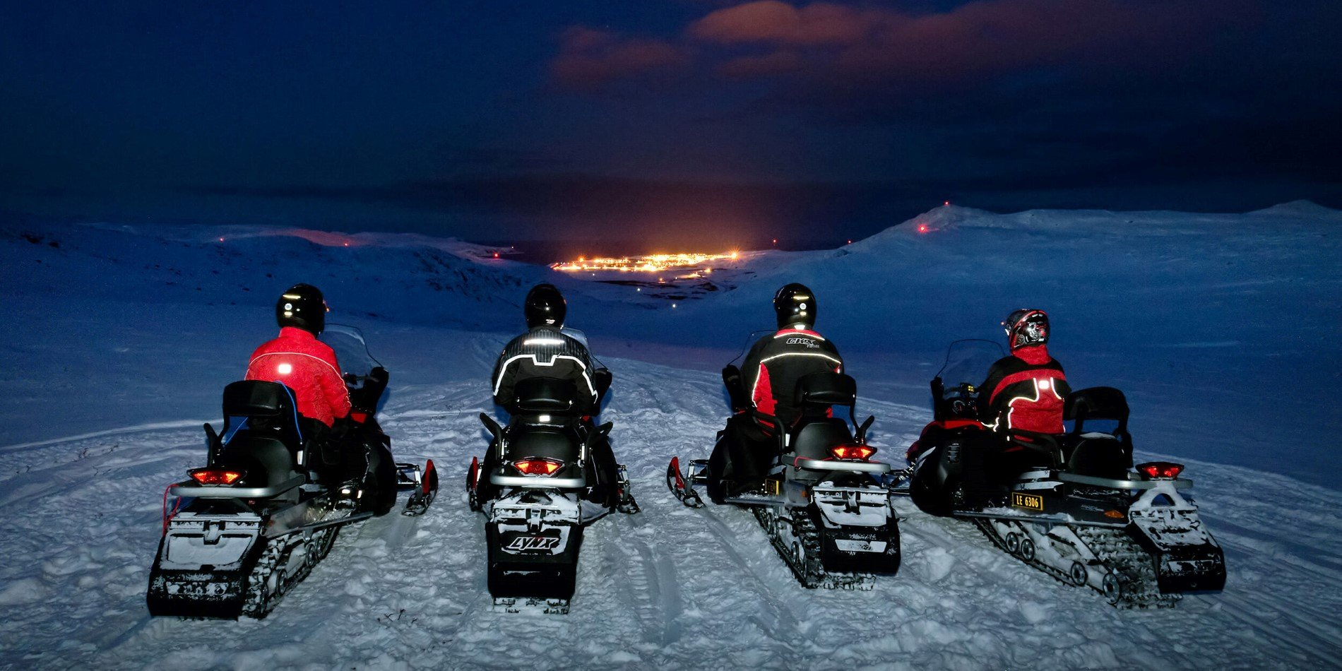 A group of people in a snowmobile