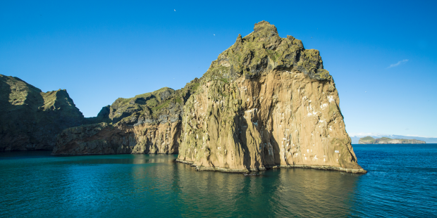 One of the island's iconic rock pillars with bird cliffs.