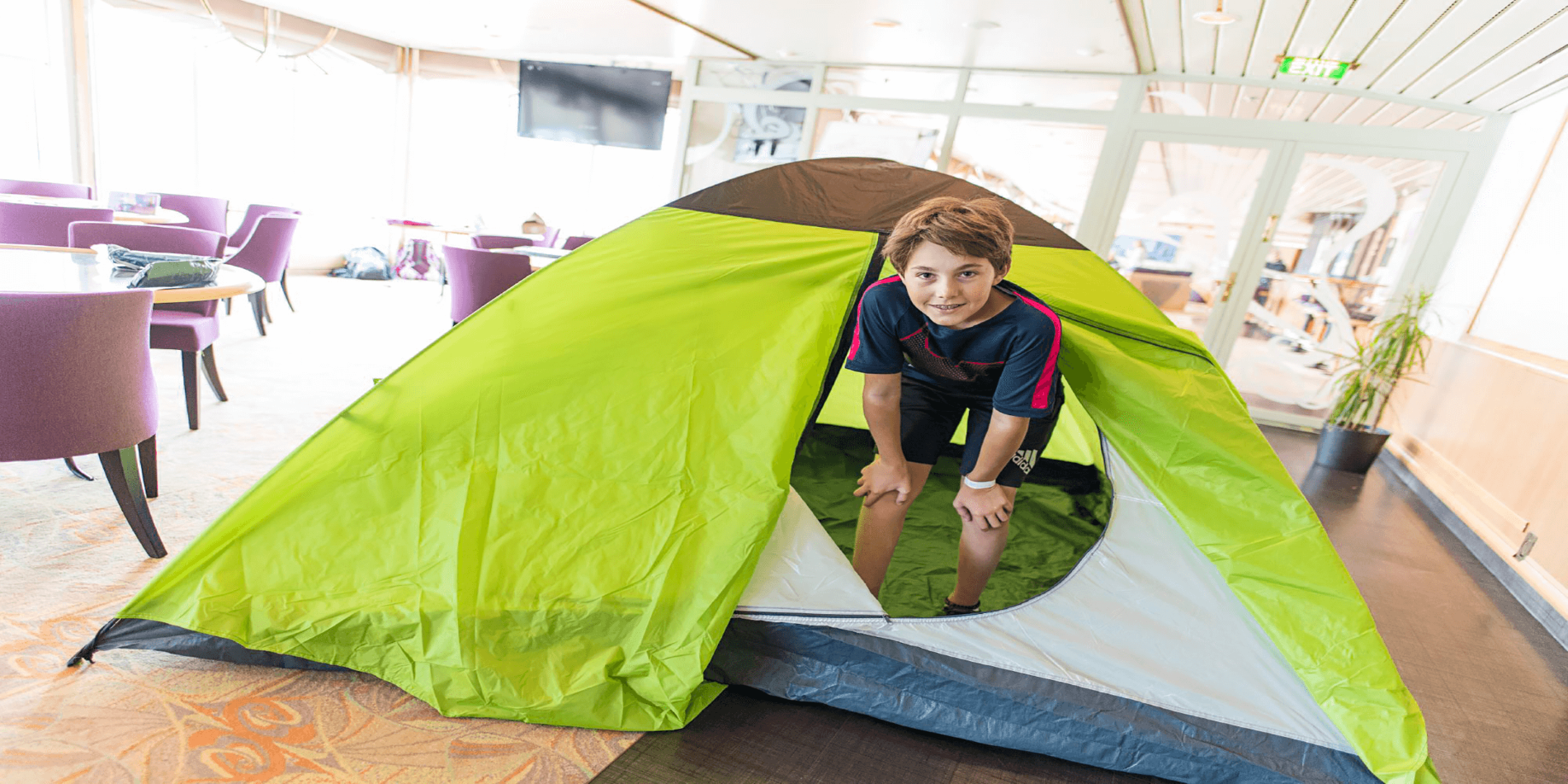 2500x1250_Young Explorers_boy in tent_Ørjan Bertelsen.png
