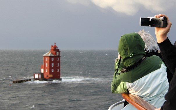 Everybody wants to take pictures of Kjerungskjær Lighthouse. On board MS Polarlys.