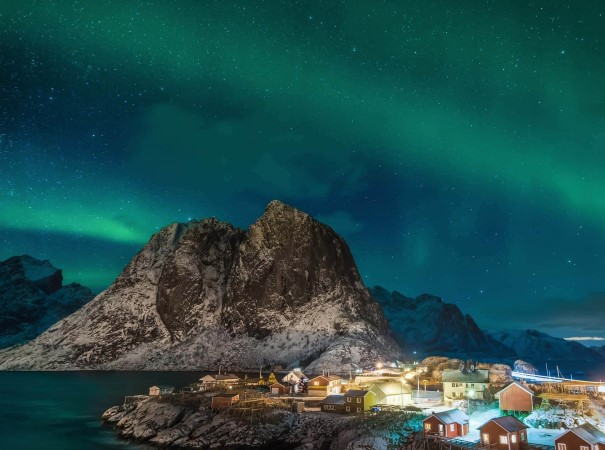 Hunt the aurora borealis on your journey along the Norwegian coast. Hamnøy in the Lofoten Islands is just one of the many possible places you may see them.