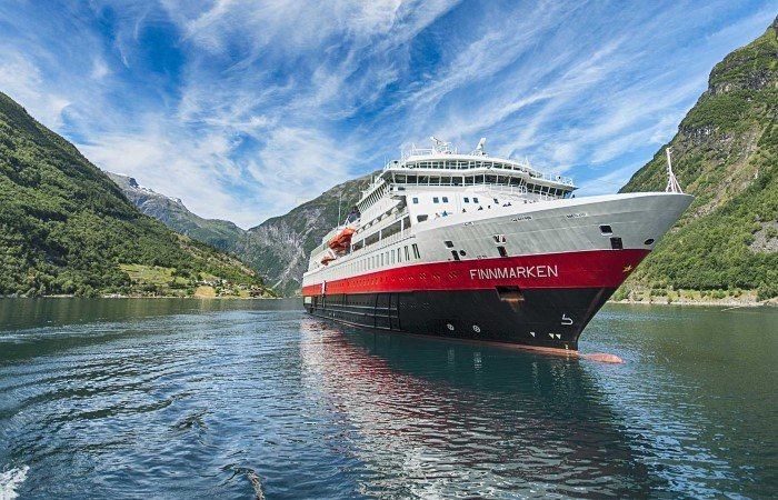 MS Finnmarken in Geirangerfjord. Here you can disembark and join excursions to Trollstigen, a winding road with dizzying views of abrupt mountainsides, waterfalls, deep fjords and valleys.