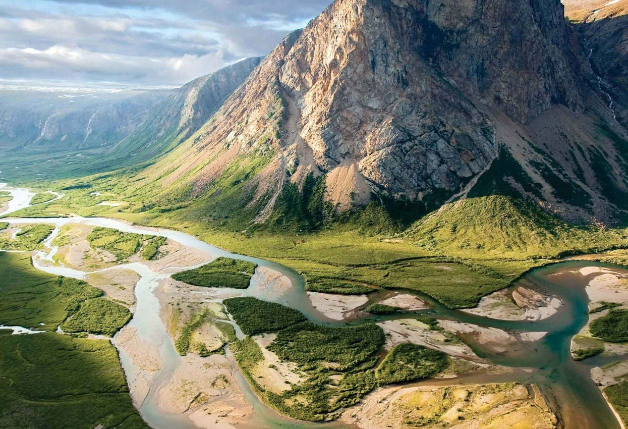 Valley with meandering river and beautiflu mountain landscape